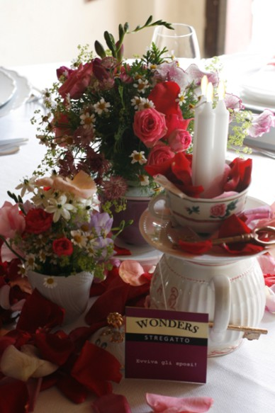 Tea pots, candles, tea bags and flowers