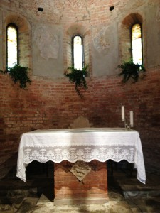 The altar has an essential style, as well as the whole building. Ancient bricks, small windows, perfect acoustics inside