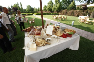 Welcoming guests with traditional food, before sitting at the table